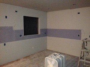 All Drywall has been hung. The Blue portion you see is a Tile Backer designed specifically for the Installation of the Tile Back Splash that will rise from the Granite Countertop to the Bottom of the Cabinets.