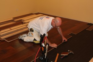 The Installation of the Engineered Flooring is shown in progress here. A #15 Felt Paper is used as a Vapor Barrier and to prevent squeaking between the wood surfaces.